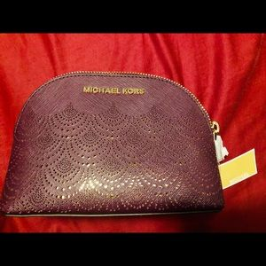 Authentic MK Travel Large pouch Wine/ Gold color